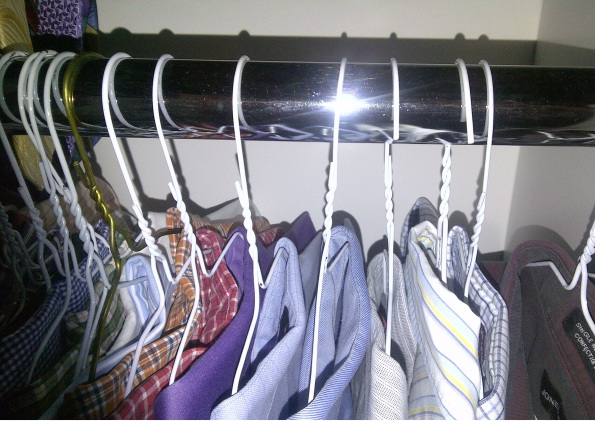 clothing (shirts) hanging in closet