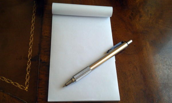 Writing pad of paper and pen