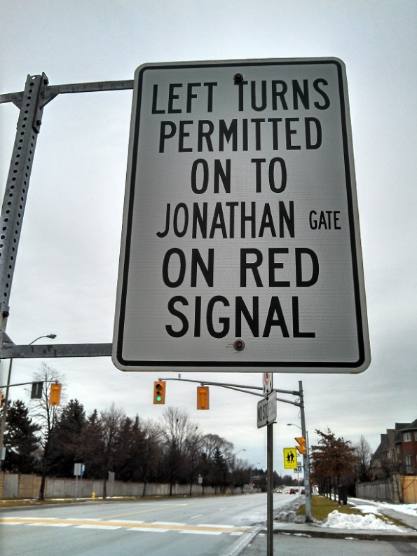 Sign allowing left turn on red light