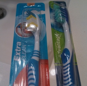 packaged toothbrushes over sink