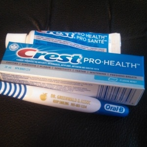 Toothpaste travel tube and box and toothbrush
